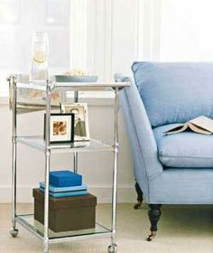 Repurpose a sleek bath cart to serve as a side table or a minibar, stocked with drinks and snacks.