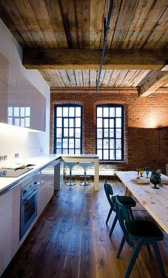 Live the exposed beams and bricks in contrast with the WHITE kitchen.