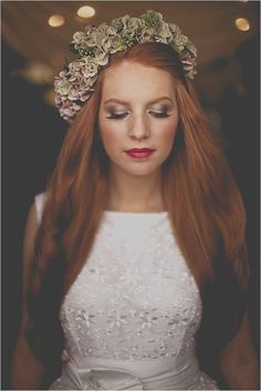Don't feel like you have to go for muted make-up: this bride's old lipstick works well with her shimmering eyeshadow and red hair. Photo | James Melia