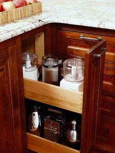 Clever Kitchen Cabinets  Add more storage capability to your kitchen cabinets by making use of corner spaces. Slim drawers are just the right size to hold small appliances or baking pans. This savvy storage solution not only takes advantage of additional space, but also keeps items off the counter, which keeps the kitchen looking tidy.