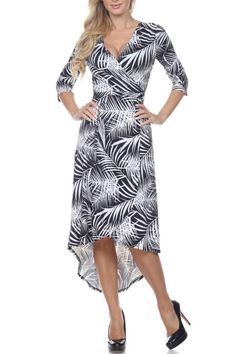 Black and white palm leaf print wrap dress features an easy drop-waist shape and flirty high-low hem. This black and white patterned midi dress reminds us of Hawaiian breezes by the beach. Perfect travel dress. Hawaiian Palm Print by Glitz & Glam Boutique. Clothing Florida