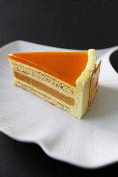 Gourmet Baking: Exotic Orange Cake - An orange vanilla bavaroise, a vanilla cremeux, a honey cake layer, a passion fruit gelee, and a white chocolate spray. Gourmet Desserts, Fancy Desserts, Just Desserts, Delicious Desserts, Gourmet Cakes, Sweet Recipes, Cake Recipes, Dessert Recipes, Gourmet Festival