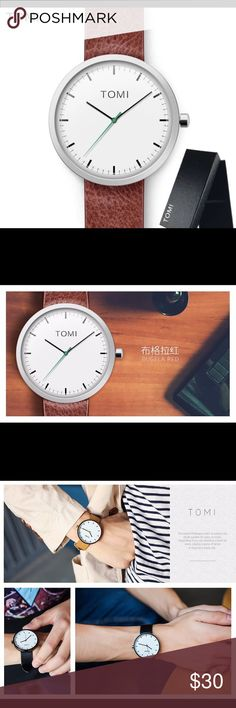 SALE! 🎉 HP! 🎉 🆕 Unisex Tomi Brown Leather Watch This watch from Tomi in Bugela Red features a brown leather strap, white 44mm dial, Quartz Movement, and it's waterproof! The simple design of the watch makes it perfect for everyday wear. This purchase also includes a small gift! Limited Quantities! Tomi Accessories Watches
