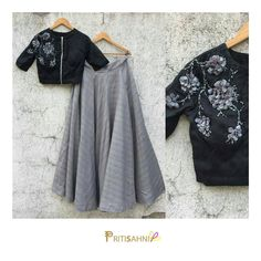 Monochrome ifeGet this chic black crop top with petal and beads floral embroidery paired with grey skirt for a fun evening with friends. Choli Designs, Lehenga Designs, Blouse Designs, Lehenga Crop Top, Lehenga Blouse, Lehenga Choli, Black Lehenga, Kids Lehenga, Indian Attire