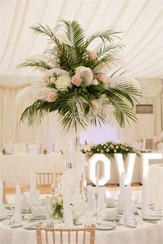 This palm leaf centrepiece from a reception at Hylands House and Grand Pavilion is both summery and glamorous