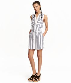 Check this out! Short, sleeveless shirt dress in woven viscose fabric. Small stand-up collar, buttons at front, chest pockets with flap and button, and side pockets. Removable tie belt at waist. Unlined. - Visit hm.com to see more.