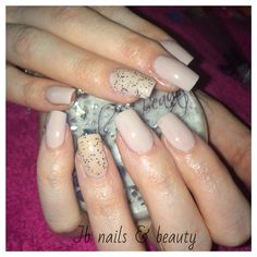 Acrylic nail extensions with nude gel polish & glitter