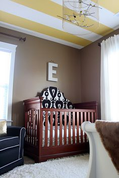 headboard in a crib?...I dunno about that but I am intrigued by the light fixture/mobile/birdcage.  I wonder what those shadows look like