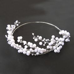Darling beaded head crown with pearl colour beads in varies sizes, line in the wire base and it is covered by silver tape. It is made of light to