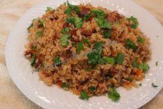 Arroz Mamposteao   Un arroz que es muy fácil de hacer con el arroz blanco y las habichuelas que te sobraron de ayer. Si te sobro carne, p...