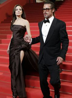 """Hollywood's first couple, Angelina Jolie and Brad Pitt, stepped out in style at the Cannes Film Festival. Angelina donned Atelier Versace at the premiere of Brad's film """"The Tree of Life"""" on May Angelina And Brad Pitt, Brad And Angie, Vivienne Marcheline Jolie Pitt, Celebrity Couples, Celebrity Photos, Celebrity Style, Atelier Versace, Jennifer Aniston, Jennifer Lawrence"""