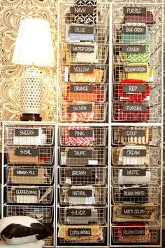 Fabric organization. Doesn't link anywhere but I like this idea. Ikea? Don't need the lamp!