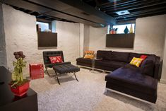 Below My Houzz: An Inviting Basement With Industrial Edge; Reconfiguring a cramped, damp basement opens up a new world of sleek, functional spaces - Rather than fighting the challenging elements, Duebber used them as elements of industrial style for a modern space that suited the clients' tastes. The result is a sleek and open space that mixes old and new elements and highlights the places where they meet.