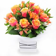 Ablaze - roses and peruvian lilies in a clean white box.