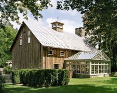 Heritage Restorations–love this barn and greenhouse.