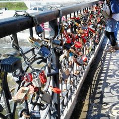 Couples place Locks of Love on bridges in Russia & Europe