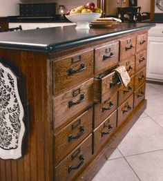 Old file cabinets repurposed into a kitchen island or use two back to back with a counter top for a sewing room cutting table with plenty of storage!