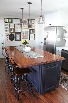 farmhouse chic: sleek walnut butcher block countertop, barn wood