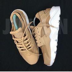 beige and white Nike huaraches.