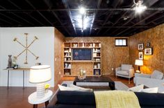 oriented strand board (OSB), a particleboard known for its rough wood strands, paired with clean white walls #industrial