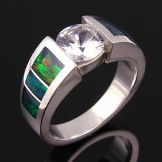 Australian opal ring with white sapphire center set in sterling silver.  Would make a very unique wedding ring!