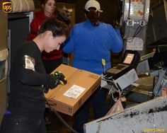 UPS worker scanning a parcel at a sorting and distribution centre in the USA