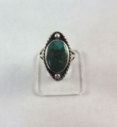Pretty dark green turquoise is set in a sterling silver shadow box style ring.