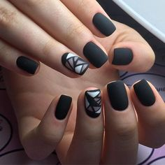 Matte Black and White Geo Nail Art. This simple yet attractive matte black geometric nail art design is made for you if you are going to a wedding or a royal party.
