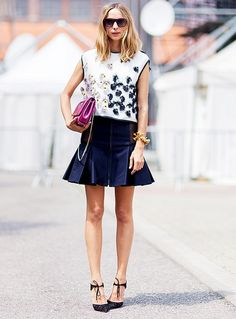 This street style star offset her feather-encrusted blouse with a structured miniskirt and black heels. // #Fashion #Style