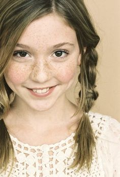 Cozi Zuehlsdorff....this would be a cute picture of my girl...braids, freckles.... :)