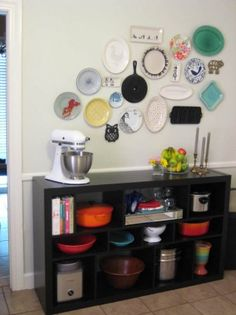 I want a plate wall in my kitchen! (And that owl trivet.)