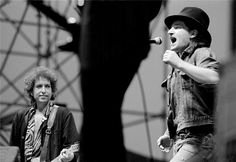 "Bono singing ""Blowin in the wind"" with Bob Dylan and Carlos Santana at Slane Ireland in 1984"