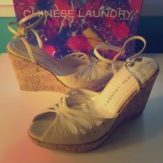 NWB | Chinese Laundry 'Vanna' Cork Wedges | 6M NWB | Chinese Laundry 'Vanna' cream colored cork wedge cutouts in a size 6M. Purchased nearly 11 years ago & recently rediscovered them in my closet. Sadly, my foot grew 1/2 a size after baby. Snatch these in time to sport this upcoming summer season! Chinese Laundry Shoes Wedges