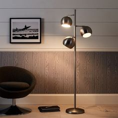 Shed light on your space with a sleek floor lamp that adds a luxe, modern touch to your room. It features three pivotal lights that to light up any part of a room in sleek Brushed Nickel finish. Led Shop Lights, Room Lights, Ceiling Lights, Spotlight Floor Lamp, Studio Lamp, Floor Lamp With Shelves, Industrial Floor Lamps, Farmhouse Lamps, Task Lamps
