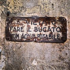 #vintage signs in the old town courtyards of Reggio Emilia - Instagram by @n_montemaggi