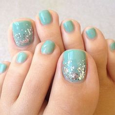 Turquoise Toe Nail with Silver Glitters on Top.