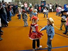 Kindergarten square dancing. So cute!! Surely if they can do it a bunch of high school graduates can too!