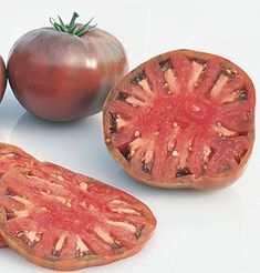 Cherokee Purple Organic Tomato Seed Product ID: 753G  Unusual variety with full flavor.  Medium-large, flattened globe fruits. Color is dusky pink with dark shoulders. Multilocular interior ranges from purple to brown to green. Relatively short vines. Indeterminate. Organically grown. Avg. 150,000 seeds/lb. Packet: 40 seeds $4.10. GROWING SEEDLINGS: Don't start too early! Root-bound, leggy plants that have open flowers or fruit when planted out may remain stunted and produce poorly. Sow in