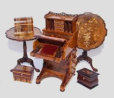Traditional miniature pieces of furniture. Love that inlay!
