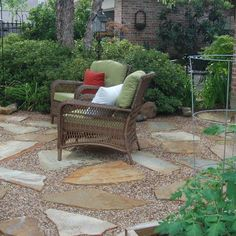 stones and pea gravel beside the patio between the rose bushes
