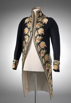 1810  Man's Cutaway Coat, French.  Wool and silk, gold embroidered leaves down coat front and cuffs.    ngv.vic.gov.au