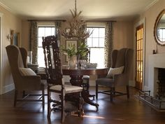 Dining room from the 1929 farmhouse of Heide Hendricks and Rafe Churchill in Sharon, Connecticut. Photo by John Gruen. Wall paint is Smoked Trout, trim paint is Slipper Satin (both by Farrow & Ball).