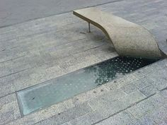 A bench lifted out of the sidewalk