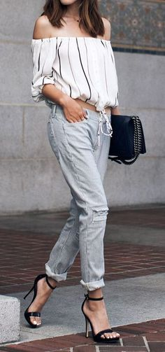 Trendy woman in striped off-the-shoulder top and striped pants