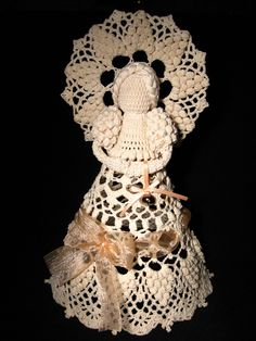 """Inspiration Piece: """"Lilian"""", crochet angel by Gosia, a woman from Poland, now living in Ireland. This little crochet angel masterpiece has arms, round wings, & skirt done up in convex popcorn stitch. Ribbons of a similar colour & a tiny bell add a finishing touch. Stiffened with potato starch to make rigid. Check the site to see more fantastic little angels / http://littleblacklace.com/2011/12/04/lilian-crochet-angel/#"""