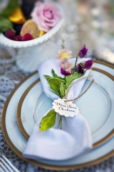 Love this idea of using mint for the silverware setting.  It's green and fresh.  Add some violets for extra color.