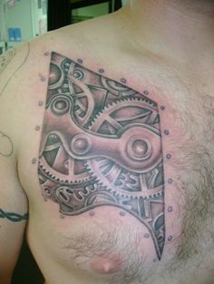 Male steampunk chest tattoo but on shoulder? Something mechanical?