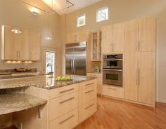 Nice two tones of wood.. I like that that the knobs have been upgraded.  Garnet counter tops is in an outdated color.