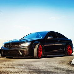 Exotic Mercedes all black with red wheels!