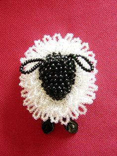 Hand-knit Beaded Sheep Pin. $10.00, via No way this is hand knit and only $10. Might have to buy one of these.